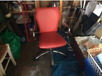 Red leather effect office chair on wheels