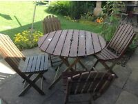 Patio table and four chairs , needs doing up