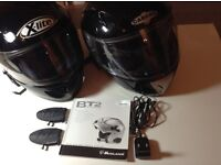 For sale, two motorcycle helmets fitted with a BT2 intercom communication unit