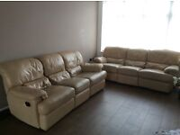Used reclining leather sofas - pair