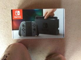 Unused and in sealed box black Nintendo switch