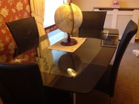 Black/clear glass dining table and 4 matching leather chairs