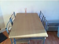 4 Seater Table + Chairs