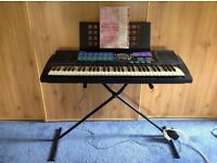 Yamaha Portatone PSR-185 61-Key (Full-Size Key) Portable Keyboard with stand and user manual