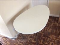 Oval shaped white desk with chrome adjustable height legs