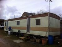 Static caravan 35 ft by 10ft perfect for renovation projects .