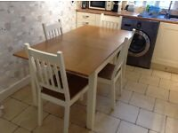 Extendable dining table and matching four chairs