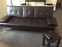 Brown sofa bed/ recliner. Very well maintained. No marks, easy to clean and comfy.