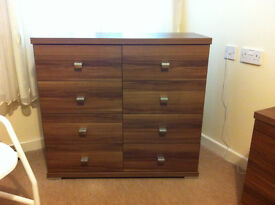Six drawer chest of drawers and two matching bedside cabinets.