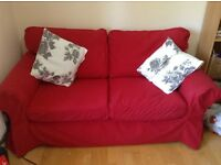 Good condition red Ikea Ektorp sofa - fully removable, machine washable covers.