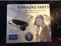 Karaoke machine and microphone almost new!