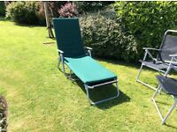 Sunloungers, two black and grey with black parasol and four matching folding chairs.