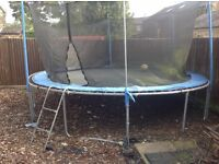 Garden Trampoline 12ft diameter net enclosure, two years old, needs a little tidying up.