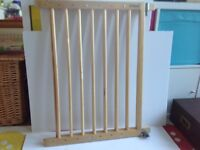 Two Lindam wooden extendable stair gates