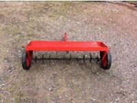 Aerator for ride on mower