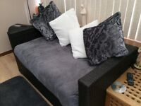Four piece wicker suite. Dark brown in colour
