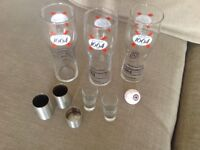3 lager glasses and a box of plastic wine glasses also some shot glasses