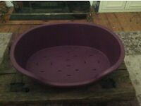 Hard plastic Pets at Home dog bed. Size Medium. Purple. Only 6 weeks old. Excellent condition.