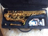 Alto Saxophone by Roy Benson with case.