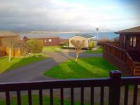 Beautiful 6 berth log cabin with panoramic sea views