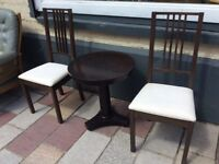 Two Ikea Chairs with nice sturdy Round Coffee Table