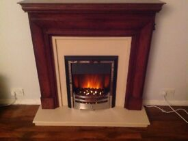 Electric fire complete with surround and hearth and remote control