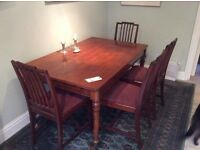 Victorian walnut dining table 136cm (W) x 88cm (D) and four modern dining chairs