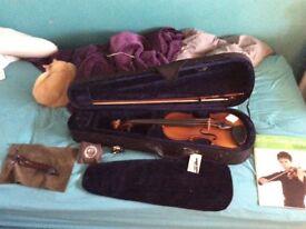 Violin,tuner,case,and book
