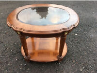 A hardwood and glass topped two tier occasional table