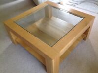 Heavy solid oak and glass coffee table in excellent condition
