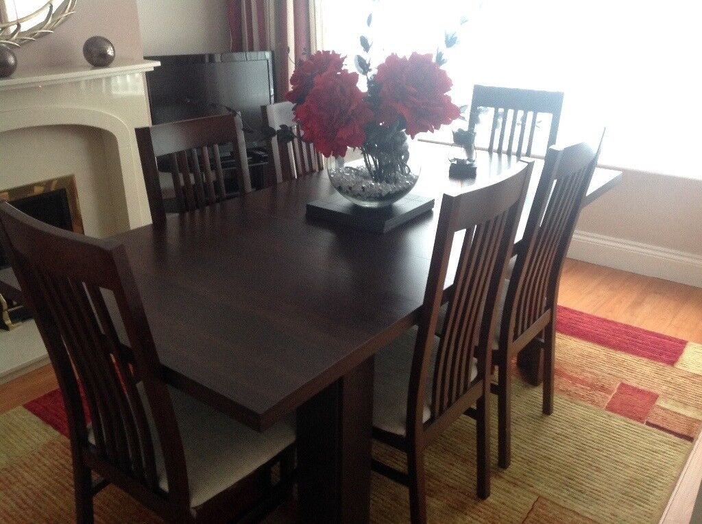 Dark Wood Dining Table With Six Matching Chairs In Good Condition