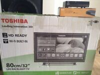 TOSHIBA 32 Inch HD SMART TV + SOUND BAR HITACHI (+ a freeview Bush as a gift )