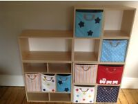 Wooden child's cube storage unit with canvass drawers