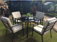 Top quality Patio Set. Table and 4 chairs with luxury cushions. Bargain £99 ovno.