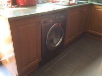 Solid oak kitchen with island and a double oven and extractor fan