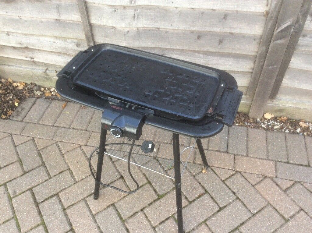ELECTRIC BARBEQUE GRILL ON STAND WITH INSTRUCTION BROCHURE