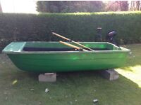Twin hulled rowing boat with 2 engines