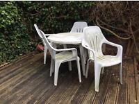 White plastic garden table and chairs
