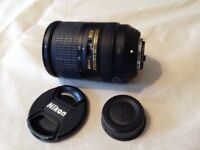 Nikon Super Wide Angle Lens with lens covers, lens hood, bag and instructions.