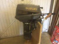 Suzuki 9.9hp outboard motor.