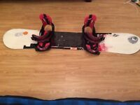 Snowboard, boots, bindings and wheelie bag