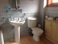 White steel bath, vanity sink and toilet