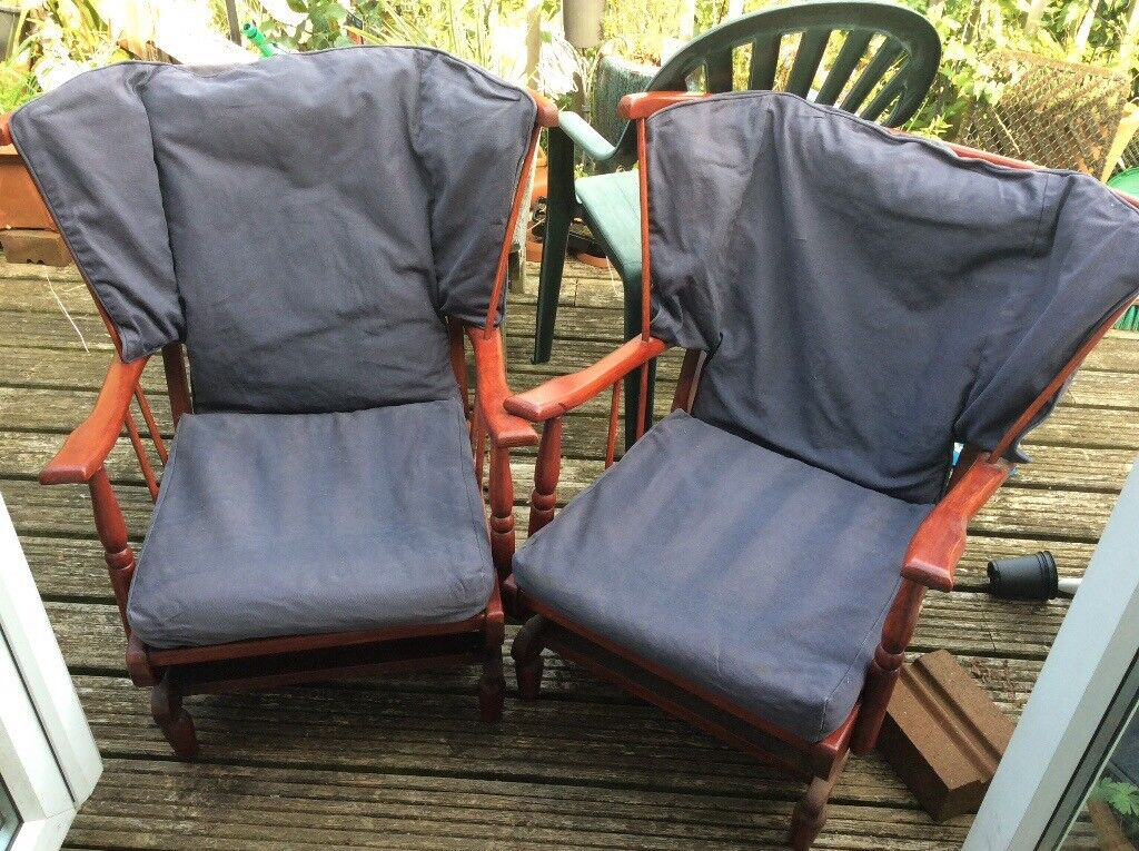 Pair of base rocking chairs with covered seat and back cushions.