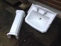 Large sink with taps and pedestal