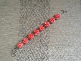 5 floral bracelets 2 red 2 coral 1 turquoise New