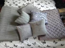 Grey throws and cushions