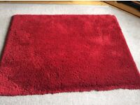 """""""Colours"""" soft touch rug in red"""