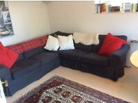 Black fabric Ikea double sofa bed in good condition.