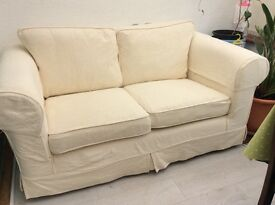 Two seater settee with two sets of covers