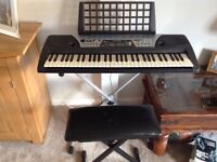 Yamaha PSR-175 keyboard with stand and seat. Boxed good condition. 100 different instruments.